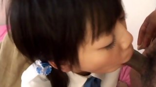 Cute Asian schoolgirl fucked with a carrot