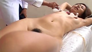 Asian milf toyed by her perverted doctor