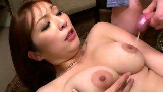 Asian bitch shoving a dildo in her cunt