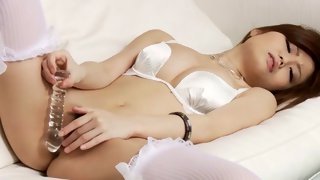 Sexy Asian slut lying on the bed