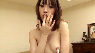 Horny Asian slut blows a guy's big dick