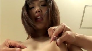 Spicy Asian bitch moans while getting toyed