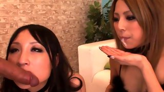 Two slutty Asians licking and eating cums