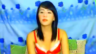 Barely legal Asian chick undresses on cam