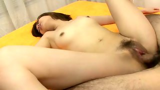 Wet Asian chick probed with a massive toy