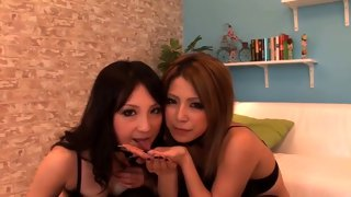 Cute Asian sluts licking a load of cum