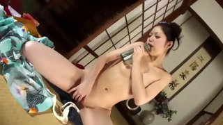 Horny Asian bitch teasing her shaved cunt