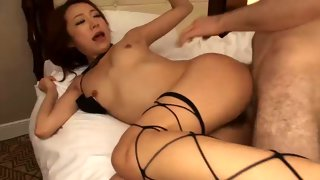 Busty Asian bitch stripping naked and teasing