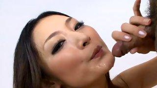 Horny Asian slut in red lingerie drinking cum