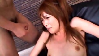 Asian whore has her holes filled with sex toys