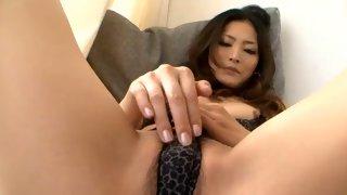 Horny Asian bitch teasing her stiff clit