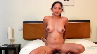 Asian innocent looking girl rides a dick