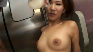 Cute Asian slut pleasuring two big dicks