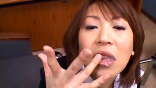 Slutty Asian bitch swallowing a large cock