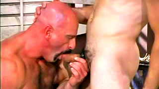 Tattooed hunk wrestles with his handsome hung lover
