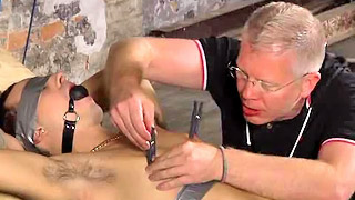 Kinky gay stud got bondaged and tortured by an older man