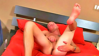 Lonely gay bloke masturbates passionately on his bed