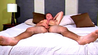 Horny college boy plays with his throbbing sausage