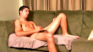 Lonely gay dude strips on the bed and jerks off his boner