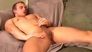 Attractive blonde gay dude strokes off his rock solid meat pole