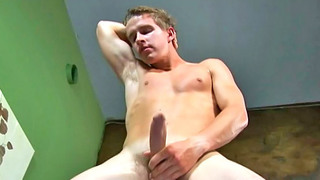 Passionate blonde gay stud strokes off his huge sausage