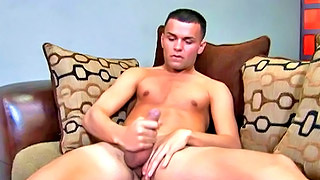 Good looking college stud plays with his own boner