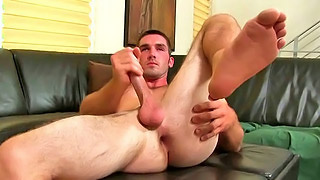 Naughty brunette dude jerks off his dong on the sofa