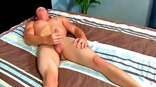 Strong blonde gay dude plays with his rock solid boner