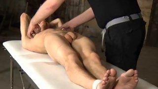 Tied up guy gets his nipples twist