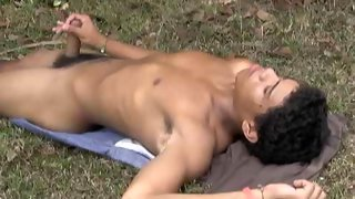 Asian bare skinned dude posing in the woods