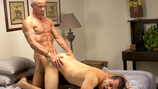 Moaning dark haired guy gets banged from behind