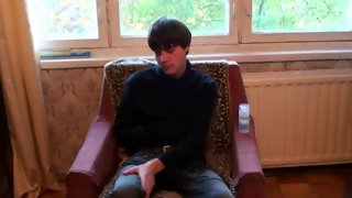 Stunning dark haired bloke posing in a chair