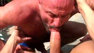 Stunning bald buck naked dude sucks cock outdoors