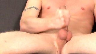 Gorgeous tattooed dude wanks his hard cock