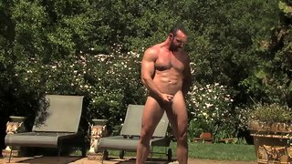 Delicious muscular stud posing naked outdoors