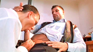 Hot gay hunk blows his partner's cock in the office