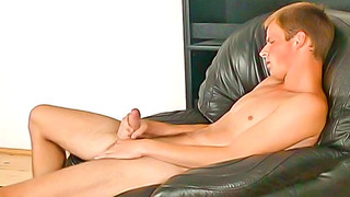 Cute gay guy passionately jerks his own rock solid shaft