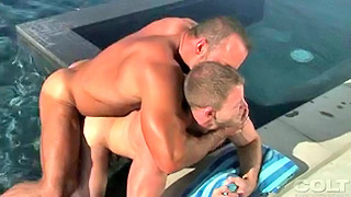 Handsome gay stud bangs his lover's ass by the pool