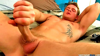Tattooed blonde gay dude shows us his big meat rod