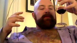 Sweet hairy bearded guy drinks wine