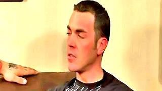 Cute gay bloke blows a throbbing hard cock on the sofa
