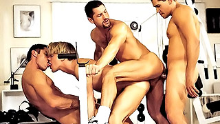 Good looking gay studs have wild group sex in the gym