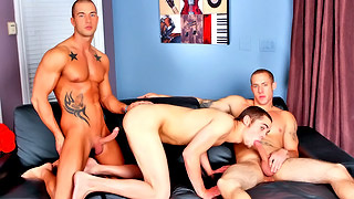 Good looking gay hunks tease us on the sofa