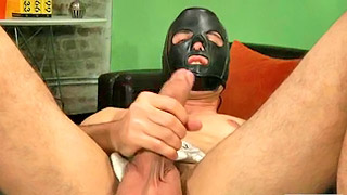 Masked gay hunk toys his own asshole