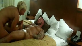 Short-haired blond chick sucks a big guy's dick