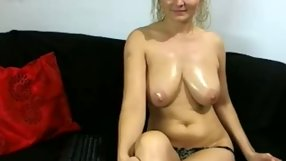 Busty chick puts a dildo in her mouth