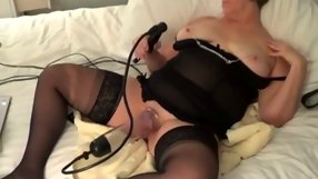 Aged skanky woman relaxing on her bed while masturbating