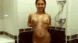 Hot tgirl soaking wet and posing for the camera