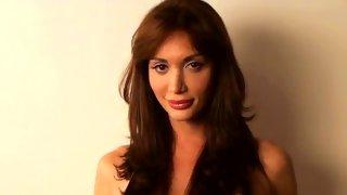 Classy Latino tranny reveals her amazing pair of tits
