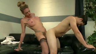 Tattooed shemale gives her lover a nasty cumshot